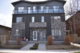 Photo 1: 1 711 17 Avenue NW in Calgary: Mount Pleasant Row/Townhouse for sale : MLS®# A1100885