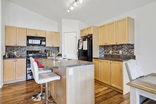 Photo 4: 204 11 PANATELLA Landing NW in Calgary: Panorama Hills Row/Townhouse for sale : MLS®# A1109912