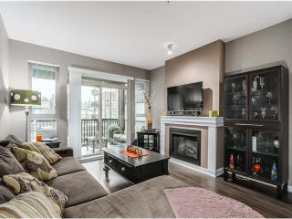 """Photo 2: 217 1153 KENSAL Place in Coquitlam: New Horizons Condo for sale in """"ROYCROFT"""" : MLS®# R2010380"""