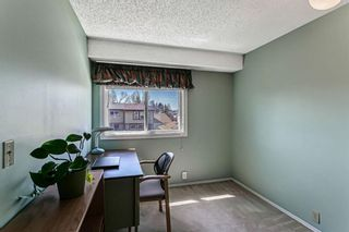 Photo 18: 1413 Ranchlands Road NW in Calgary: Ranchlands Row/Townhouse for sale : MLS®# A1133329