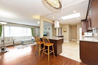 Photo 7: 709 QUADLING Avenue in Coquitlam: Coquitlam West House for sale : MLS®# R2577078