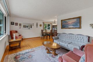Photo 4: 21 Cadogan Road NW in Calgary: Cambrian Heights Detached for sale : MLS®# A1138716