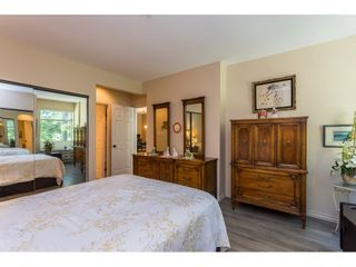"""Photo 16: 102 2733 ATLIN Place in Coquitlam: Coquitlam East Condo for sale in """"ATLIN COURT"""" : MLS®# R2475795"""