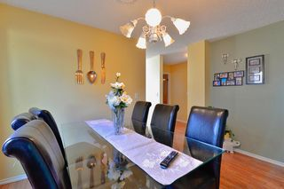 Photo 10: 8207 Ranchview Drive NW in Calgary: Ranchlands Detached for sale : MLS®# A1115978