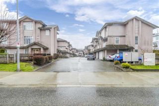 """Photo 1: 17 2538 PITT RIVER Road in Port Coquitlam: Mary Hill Townhouse for sale in """"RIVER COURT"""" : MLS®# R2549058"""