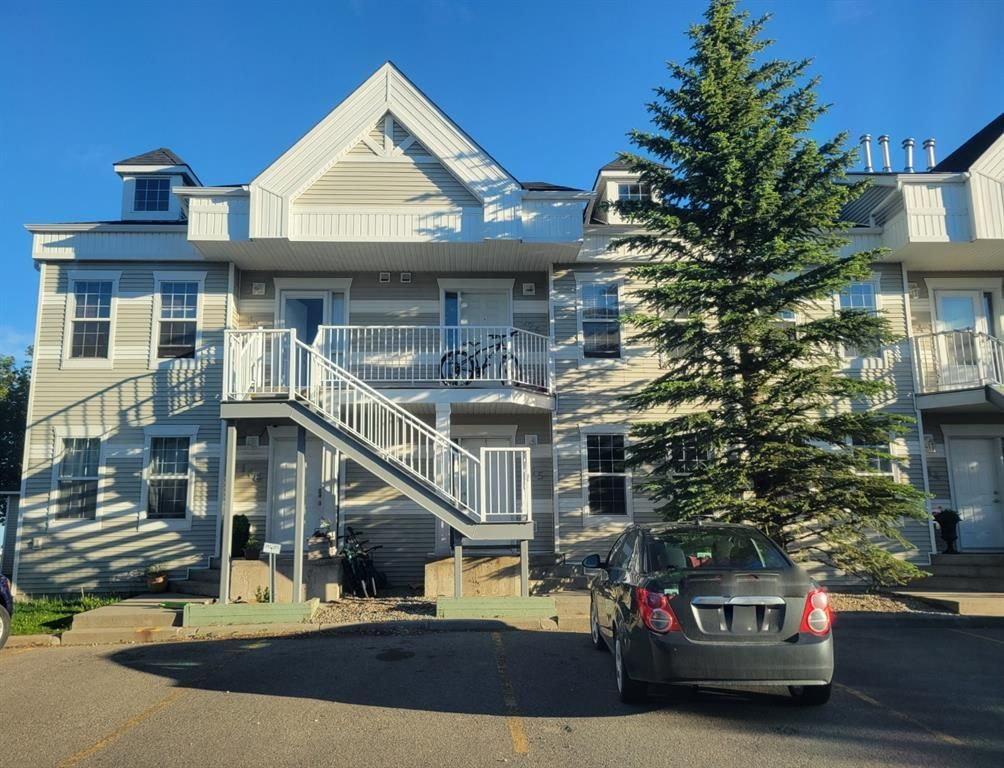 Main Photo: 115 103 Strathaven Drive: Strathmore Row/Townhouse for sale : MLS®# A1124423