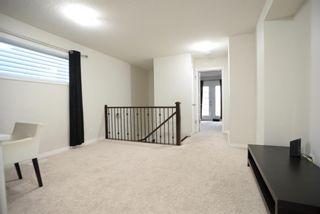 Photo 3: 86 Cranford Park SE in Calgary: Cranston Detached for sale : MLS®# A1153892
