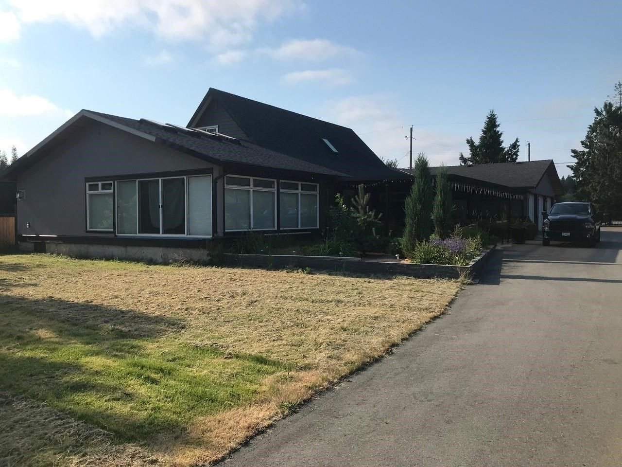 Main Photo: 19771 8 Avenue in Surrey: Campbell Valley House for sale (Langley)  : MLS®# R2597973