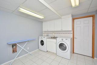 Photo 44: 303 GLENEAGLES View: Cochrane House for sale : MLS®# C4130061