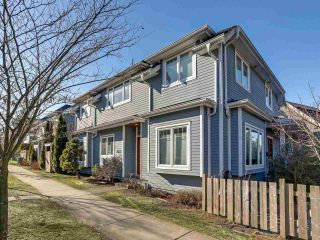 Photo 1: 4103 INVERNESS Street in Vancouver: Knight 1/2 Duplex for sale (Vancouver East)  : MLS®# R2339162