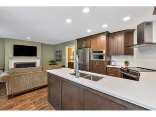"""Photo 11: 118 6109 W BOUNDARY Drive in Surrey: Panorama Ridge Townhouse for sale in """"LAKEWOOD GARDENS"""" : MLS®# R2625696"""