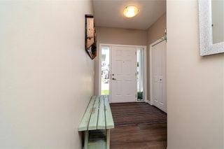 Photo 6: 430 RIVER HEIGHTS Crescent: Cochrane Semi Detached for sale : MLS®# C4189900