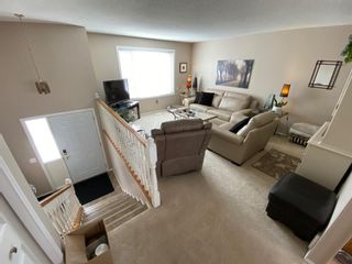Photo 3: 105 Fairway View: High River Row/Townhouse for sale : MLS®# A1152855