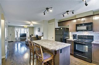 Photo 7: 161 Rainbow Falls Manor: Chestermere Row/Townhouse for sale : MLS®# A1083984