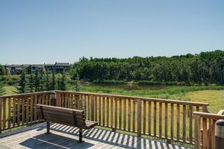 Photo 26: 111 Ascot Point SW in Calgary: Aspen Woods Row/Townhouse for sale : MLS®# A1144877