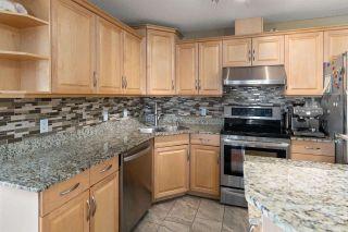 Photo 5: 325 2436 GUARDIAN Road in Edmonton: Zone 58 Condo for sale : MLS®# E4242952