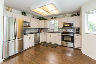 """Photo 2: 28 2352 PITT RIVER Road in Port Coquitlam: Mary Hill Townhouse for sale in """"SHAUGHNESSY ESTATES"""" : MLS®# R2098696"""