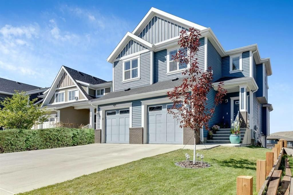 Main Photo: 744 RIVER HEIGHTS Crescent: Cochrane Semi Detached for sale : MLS®# A1026785