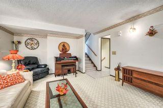 Photo 18: 335 Queensland Place SE in Calgary: Queensland Detached for sale : MLS®# C4303252
