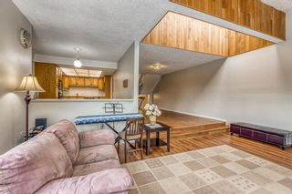 Photo 8: 10 Coach  Manor Rise SW in Calgary: Coach Hill Row/Townhouse for sale : MLS®# A1077472