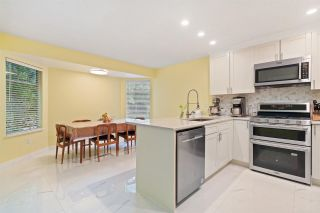 Photo 1: 9299 BRAEMOOR Place in Burnaby: Forest Hills BN Townhouse for sale (Burnaby North)  : MLS®# R2587687