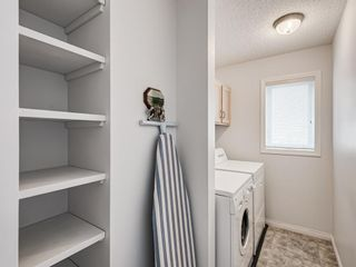 Photo 20: 54 Signature Close SW in Calgary: Signal Hill Detached for sale : MLS®# A1124573