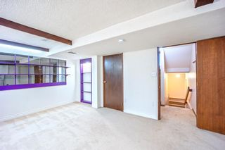 Photo 34: 7050 Edgemont Drive NW in Calgary: Edgemont Row/Townhouse for sale : MLS®# A1108400