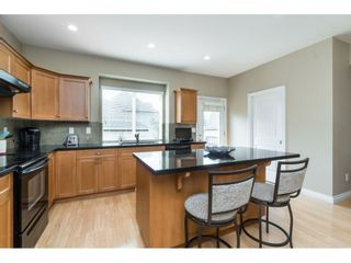 """Photo 7: 7033 179A Street in Surrey: Cloverdale BC Condo for sale in """"Provinceton"""" (Cloverdale)  : MLS®# R2392761"""