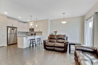 Photo 19: 333 Heartland Crescent: Cochrane Semi Detached for sale : MLS®# A1063240