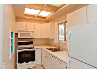 Photo 8: 229 QUEENSLAND Drive SE in Calgary: Queensland House for sale : MLS®# C4022795