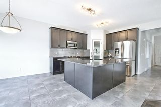 Photo 8: 61 Everhollow Green SW in Calgary: Evergreen Detached for sale : MLS®# A1115077