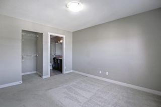 Photo 19: 555 Redstone View NE in Calgary: Redstone Row/Townhouse for sale : MLS®# A1149779