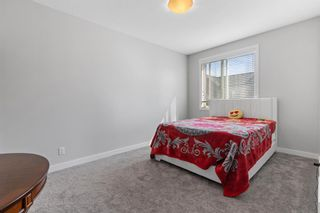 Photo 16: 903 Redstone Crescent NE in Calgary: Redstone Row/Townhouse for sale : MLS®# A1096519