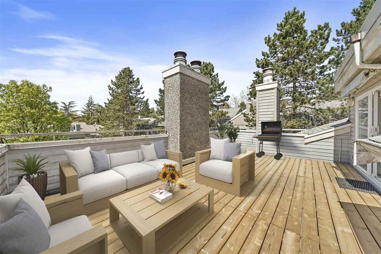 Exceptionally large patio overlooking the inner courtyard.  Beautiful place to relax on those lazy summer days