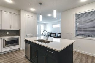 Photo 15: 618 148 Avenue NW in Calgary: Livingston Detached for sale : MLS®# A1149681