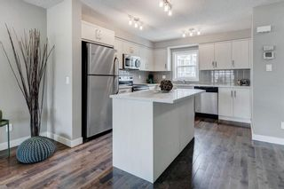 Photo 7: 205 1225 Kings Heights Way SE: Airdrie Row/Townhouse for sale : MLS®# A1122375