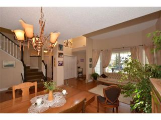 Photo 23: 148 GLENEAGLES Close: Cochrane House for sale : MLS®# C4010996