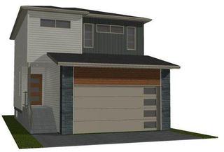 Photo 1: 809 Vaughan Avenue in Selkirk: R14 Residential for sale : MLS®# 202124828