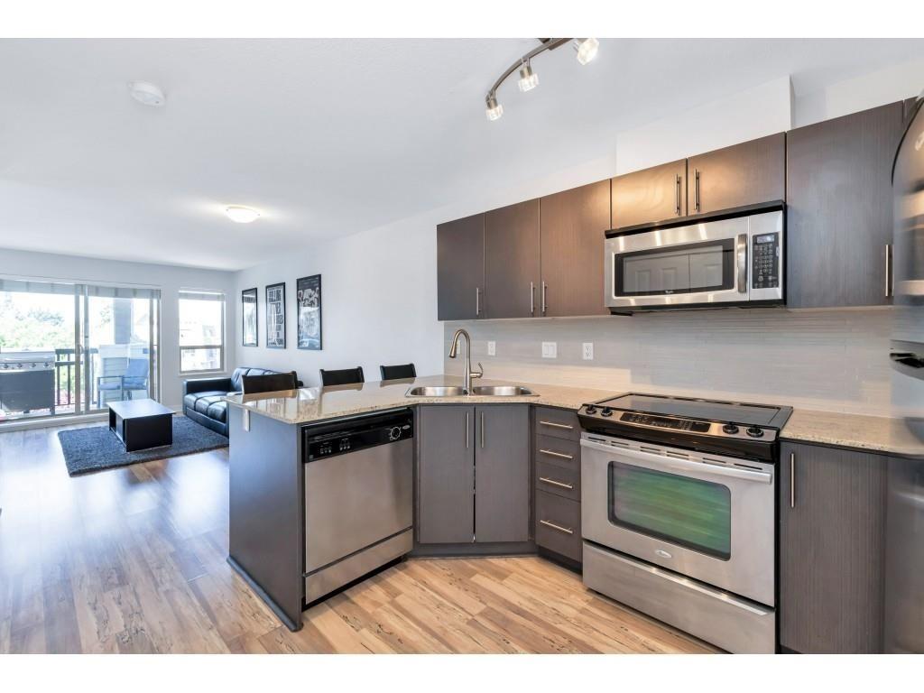"Main Photo: 403 8915 202 Street in Langley: Walnut Grove Condo for sale in ""Hawthorne"" : MLS®# R2596727"