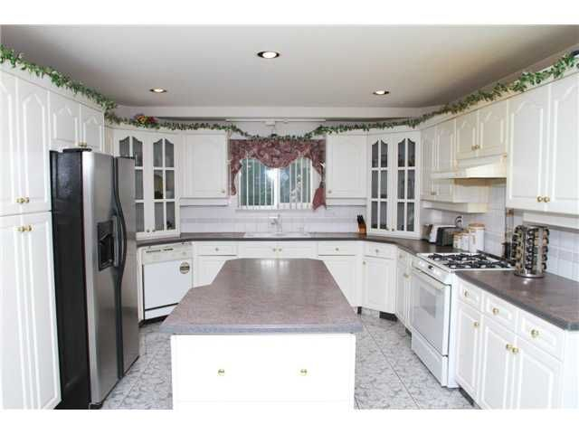"""Photo 9: Photos: 8557 11TH Avenue in Burnaby: The Crest House for sale in """"CARIBOO-CUMBERLAND"""" (Burnaby East)  : MLS®# V885657"""