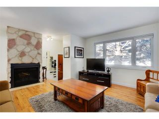 Photo 4: 803 104 Avenue SW in Calgary: Southwood House for sale : MLS®# C4092868
