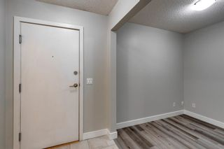 Photo 2: 338 35 Richard Court SW in Calgary: Lincoln Park Apartment for sale : MLS®# A1124714