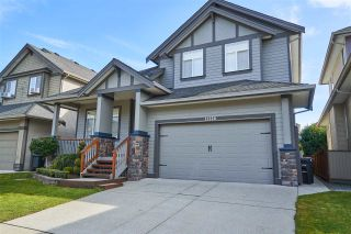 """Photo 1: 11228 TULLY Crescent in Pitt Meadows: South Meadows House for sale in """"Bonson's Landing"""" : MLS®# R2246447"""