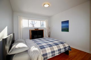 Photo 13: 915 40 Avenue NW in Calgary: Cambrian Heights Detached for sale : MLS®# A1050845
