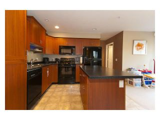 """Photo 2: 101 3000 RIVERBEND Drive in Coquitlam: Coquitlam East House for sale in """"RIVERBEND"""" : MLS®# V859605"""