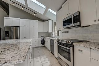 Photo 12: 512 Coach Grove Road SW in Calgary: Coach Hill Detached for sale : MLS®# A1127138