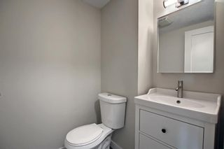 Photo 13: 77 123 Queensland Drive SE in Calgary: Queensland Row/Townhouse for sale : MLS®# A1145434