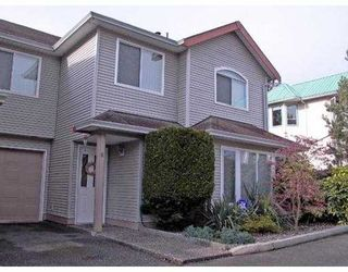 "Photo 1: 19274 FORD Road in Pitt Meadows: Central Meadows Townhouse for sale in ""MONTERRA SOUTH"" : MLS®# V587091"