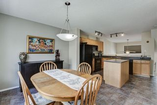 Photo 7: 85 TUSCANY Court NW in Calgary: Tuscany Row/Townhouse for sale : MLS®# C4243968