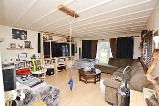 Photo 4: 121 & 125 EDGAR Avenue: Turner Valley Detached for sale : MLS®# A1105360